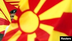 Macedonia -- A boy waves the Macedonian flag during an anti-government demonstration in Skopje, May 17, 2015.