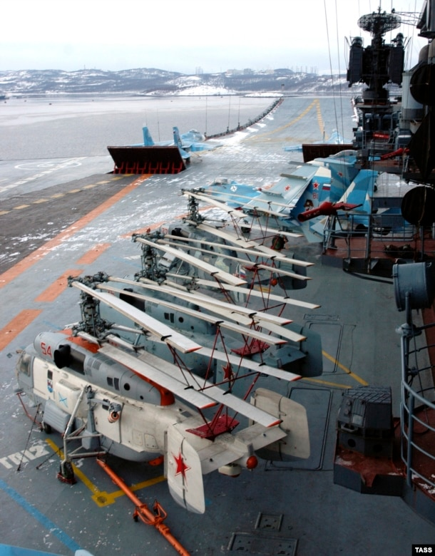 Helicopters and fighter jets on the flight deck of the Admiral Kuznetsov. The carrier is capable of deploying with 52 aircraft aboard. The vessel's air wing, however, is limited by its lack of an aircraft catapult. Most modern aircraft carriers are fitted with a steam-powered catapult that flings aircraft along the deck runway.