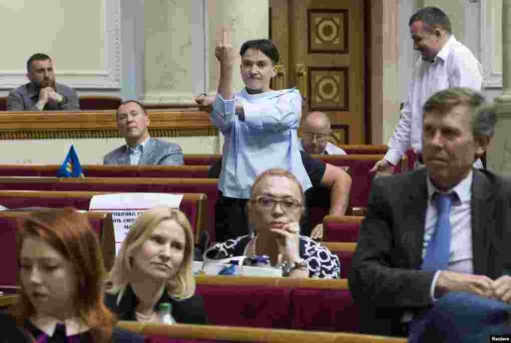 Ukrainian lawmaker Nadia Savchenko makes an obscene gesture during a session of the parliament in Kyiv. (Reuters/Vladyslav Musiienko)