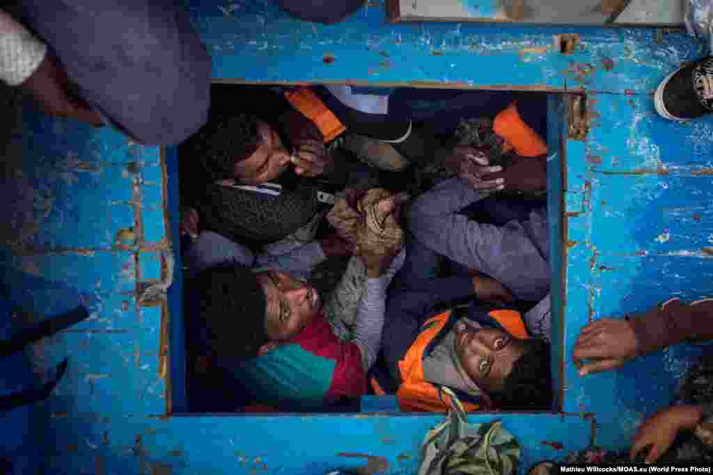 Eritreans migrants seen cramped in the hold of a large wooden boat which carried approximately 540 men women and children, mostly Eritreans.  Spot News -- Third Prize, Stories (Mathieu Willcocks, MOAS)
