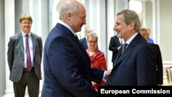 Belarusian President Alyaksandr Lukashenka (left) meets with EU enlargement commissioner Johannes Hahn in Minsk last year.