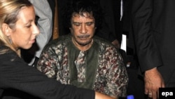 Muammar Qaddafi reportedly relies on a team of Ukrainian nurses