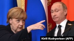 Lost in translation? German Chancellor Angela Merkel (left) gestures as Russian President Vladimir Putin looks on during the pair's joint press conference at the Kremlin in Moscow on May 10.