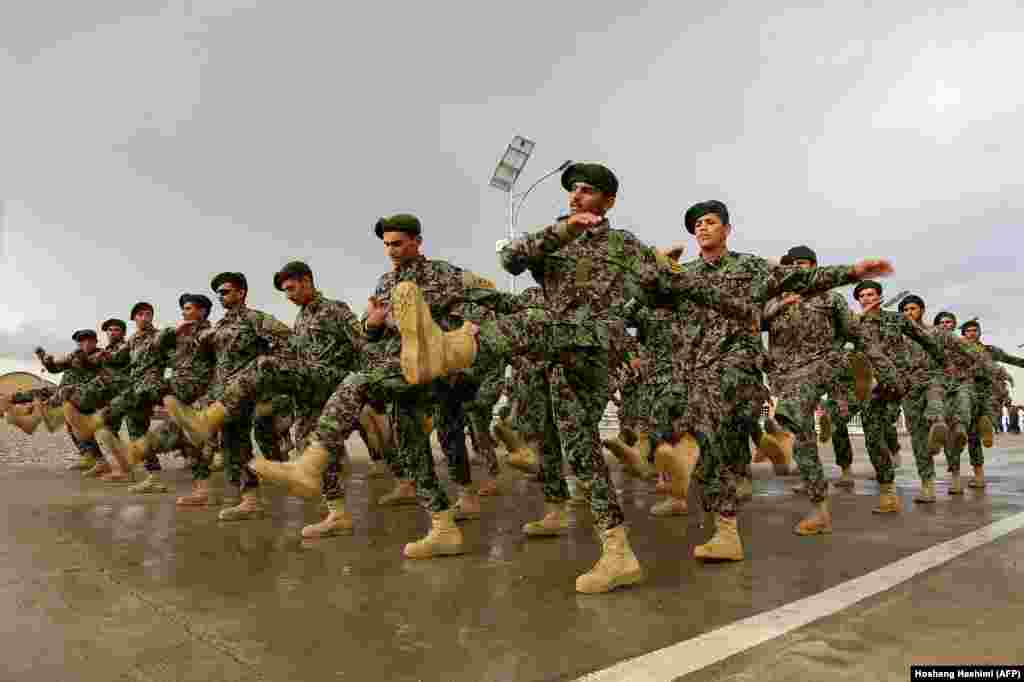 Afghan National Army soldiers marching during a training exercise for a graduation ceremony at a training center in Herat Province. (AFP/Hoshang Hashimi)