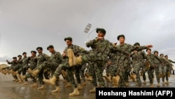 FILE: Afghan National Army (ANA) soldiers march during a training exercise of a graduation ceremony at a training center in Herat Province (April 2018).