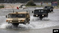 Патруль Національної гвардії США рухається уздовж затопленого берега в штаті Міссісіпі, 28 серпня 2012 року