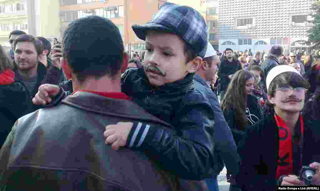 "A young participant in the ""Mustache Men"" celebration"