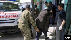 Afghan soldiers and voluntaries carry an injured man to a hospital following a suicide bomber attack with explosives packed in a vehicle in Ghazni Province on May 22.