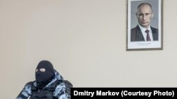 Dmitry Markov photo has become a symbol of the recent protests, the biggest anti-government rallies in years.