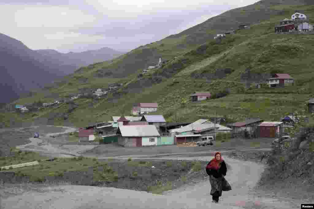 A woman walks along a road in the settlement of Akhty in southern Daghestan.