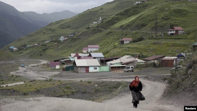 A woman on a road in the settlement of Akhty in southern Daghestan.