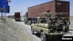 Pakistani paramilitary soldiers escort a convoy of trucks, carrying supplies for NATO troops in Afghanistan, before crossing into Afghanistan from the Pakistan border town of Chaman. (file photo)
