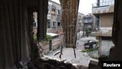 Хомс қаласындағы талқан болған үйлердің бірі. 9 мамыр 2013 жыл