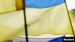Ukraine -- Ukrainian national flags, flags of Ukrainian trade unions and EU flag are seen during a mass rally in front of the Ukrainian cabinet of ministers building in Kyiv, October 15, 2014