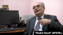 Профессор Хамза Камол