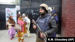 A Pakistani police commando stands guard outside a church during Christmas Mass in Lahore on December 25.