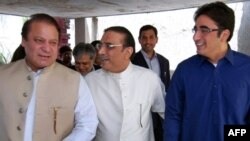 Sharif (left) and Zardari (center) appear to have widely divergent goals.