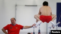 Coach of the gymnastics Russian Olympic team Valery Alfosov and team member Nikolai Kuksenkov