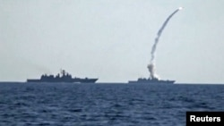 A missile is fired from a Russian warship in the Mediterranean Sea on June 22.