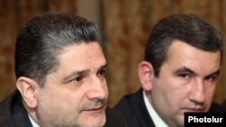 Armenia -- Prime Minister Tigran Sarkisian (L) and Artak Shaboyan, head of the State Commission on the Protection of Economic Competition (SCPEC), at an international seminar in Yerevan, 21Mar2011.
