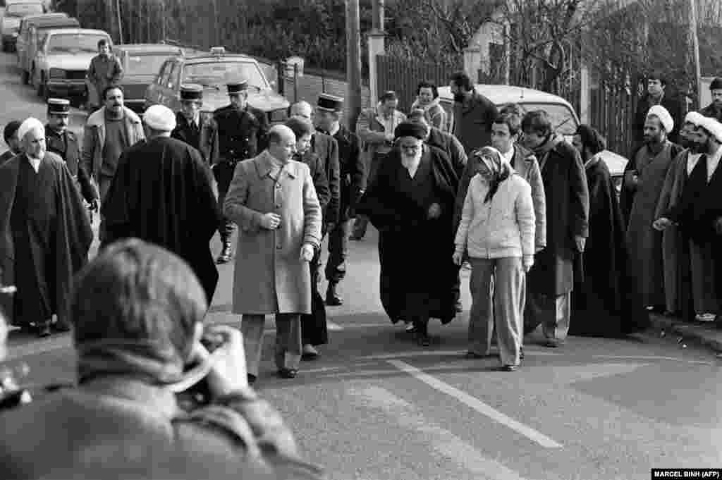 Ayatollah Ruhollah Khomeini leaves his villa in Neauphle-le-Chateau, near Paris, on January 31, 1979, to board an Air France jet bound for Tehran.