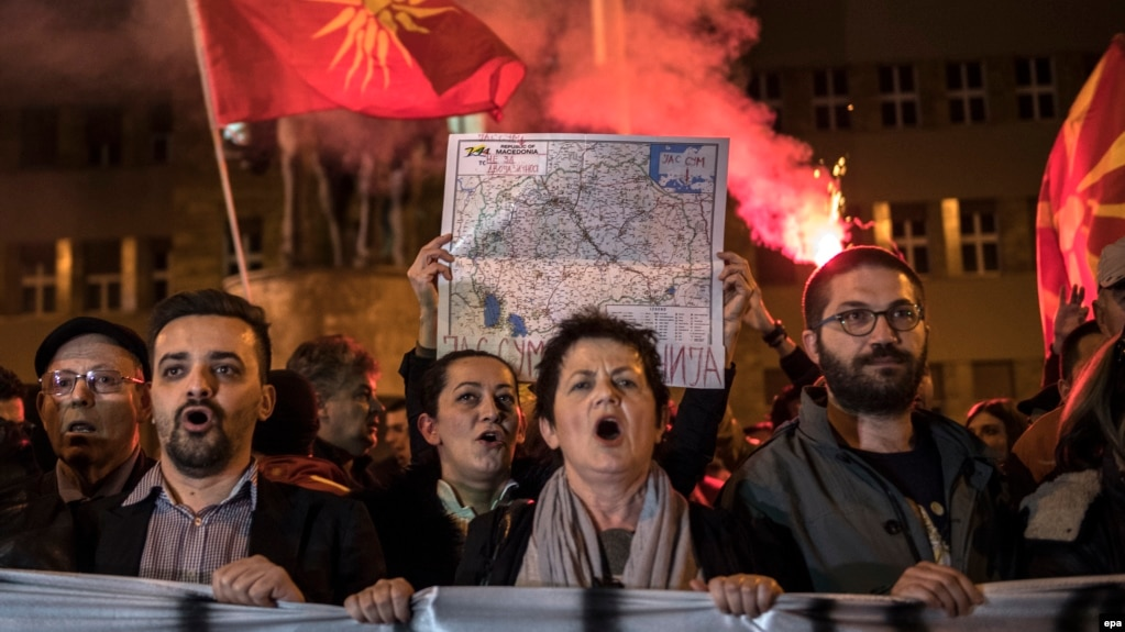 Protesters in the Macedonian capital Skopje protest against a political agreement that would ensure the wider use of the Albanian language in the ethnically divided state.