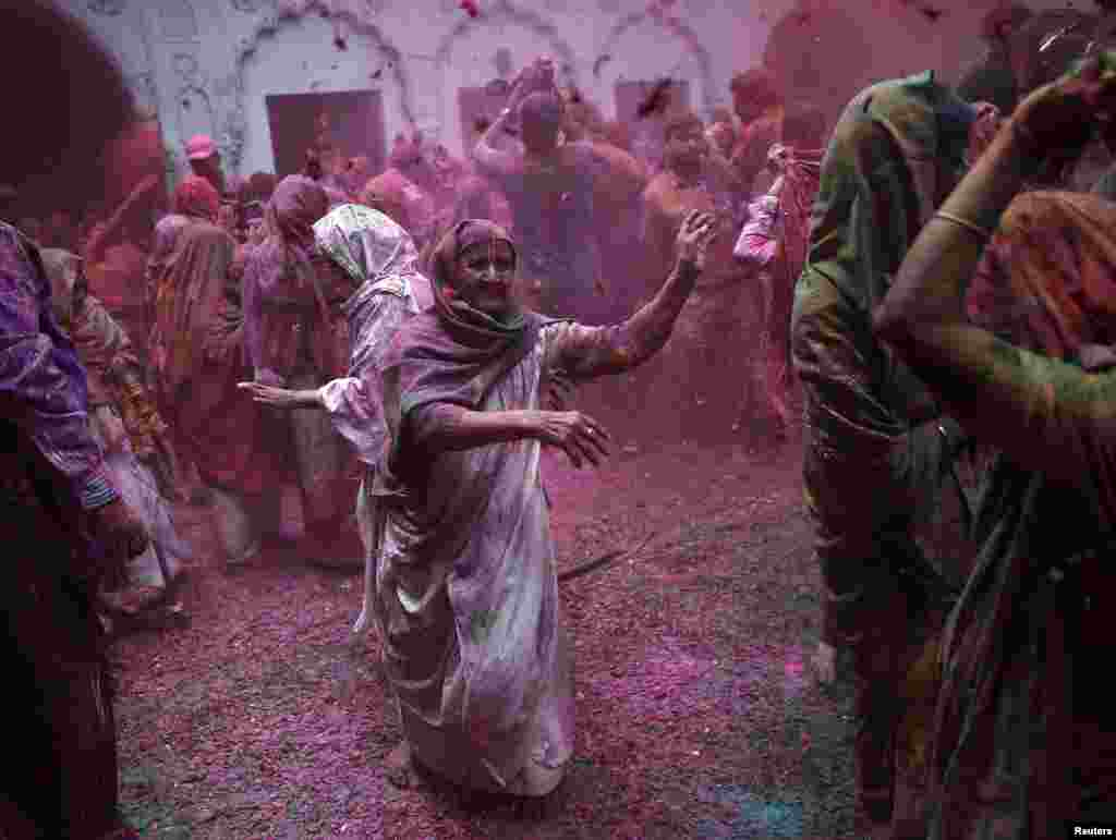 Widows daubed in colours take part in celebrations for Holi festival in Vrindavan in the northern Indian state of Uttar Pradesh on March 3. (Reuters/Ahmad Masood)