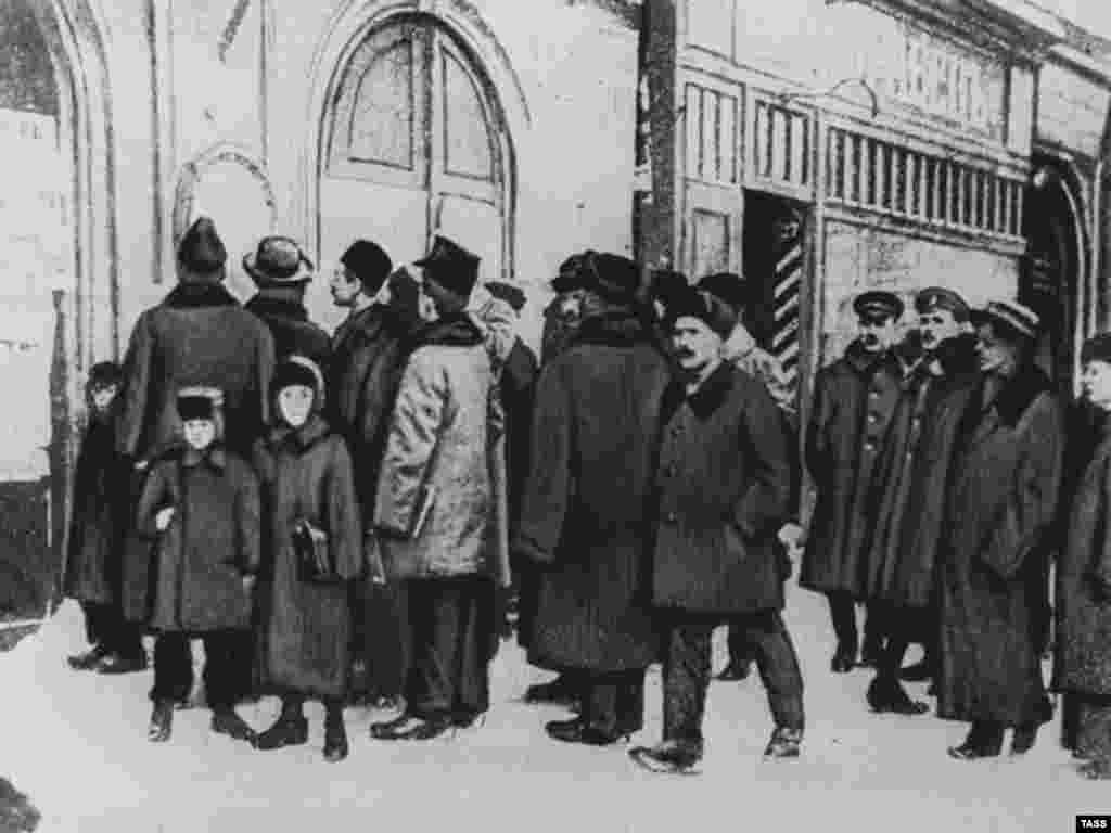 Petrograd residents read decrees posted by the new Soviet government in 1917 - In short order, the Bolsheviks issued decrees nationalizing banks, factories, and agricultural land. They negotiated a withdrawal from World War I in March 1918. They seized the property of the Russian Orthodox Church and cancelled the country's foreign debt.