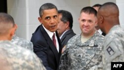 U.S. President Barack Obama shakes hands with Iraq war veterans at Fort Bliss, Texas, last year.