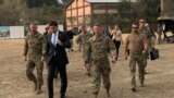 U.S. Defense Secretary Mark Esper (center) walks with Gen. Scott Miller, (right), chief of the U.S.-led coalition in Afghanistan, at the U.S. military headquarters in Kabul on October 20.