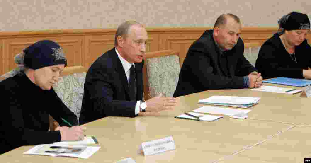 President Putin meeting with representatives of the Mothers of Beslan Committee in Moscow on September 2, 2005 (epa) - Officials say hostage takers started the massacre by setting off a bomb inside the school. Aleksandr Torshin, the head of an official parliamentary commission investigating the events, has thrown his weight behind this version.