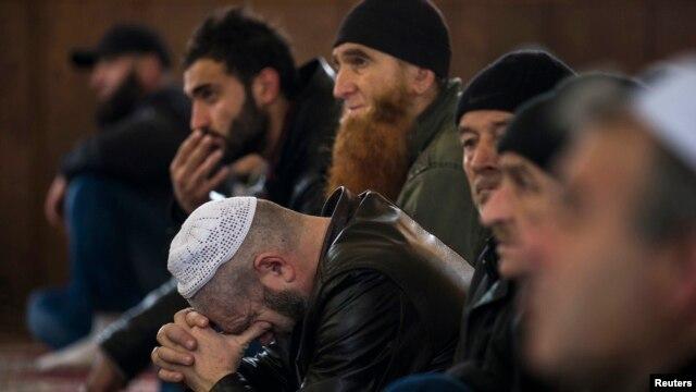 Crimean Tatars listen to a sermon in the Khan Chair mosque in Bakhchisaray, near Simferopol.