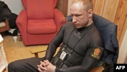 Norwegian right-wing extremist Anders Behring Breivik sits handcuffed and dressed as a police officer moments after his arrest, following a massacre on Utoya Island last year.