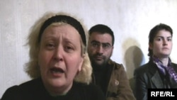 Armenia -- Anahit Khalafian (L), mother of a man who died in police custody, speaks to RFE/RL, 19 April 2010.