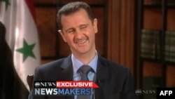 Башар Асад во время телеинтервью. 7 декабря 2011 года