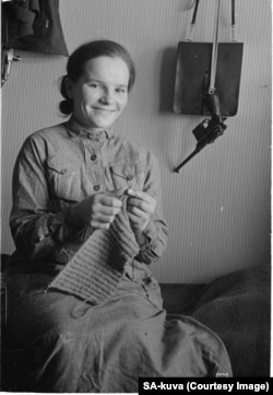 A Finnish woman with a handgun in her homestead. For Finns, the war was a crisis that unified the people and morale among fighters was relatively high.