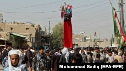 Afghan Shi'a devotees attend a mourning procession commemorating Ashura in Kandahar on September 20.