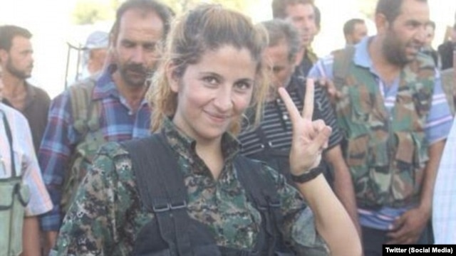 A Kurdish female fighter named 'Rehana' has become an iconic figure in the fight against Islamic State ever since this picture was widely circulated on social media.