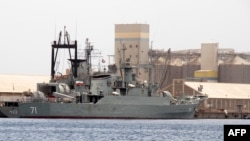 the Iranian warships Alvand (right) and Bushehr are seen docked for refueling in Port Sudan in May 2014.