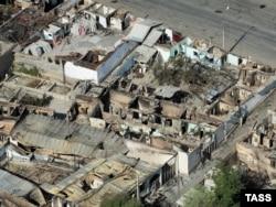 Оштағы ұлтаралық қақтығыстар кезінде ойран болған тұрғын үйлер. 18 маусым 2010 ж.