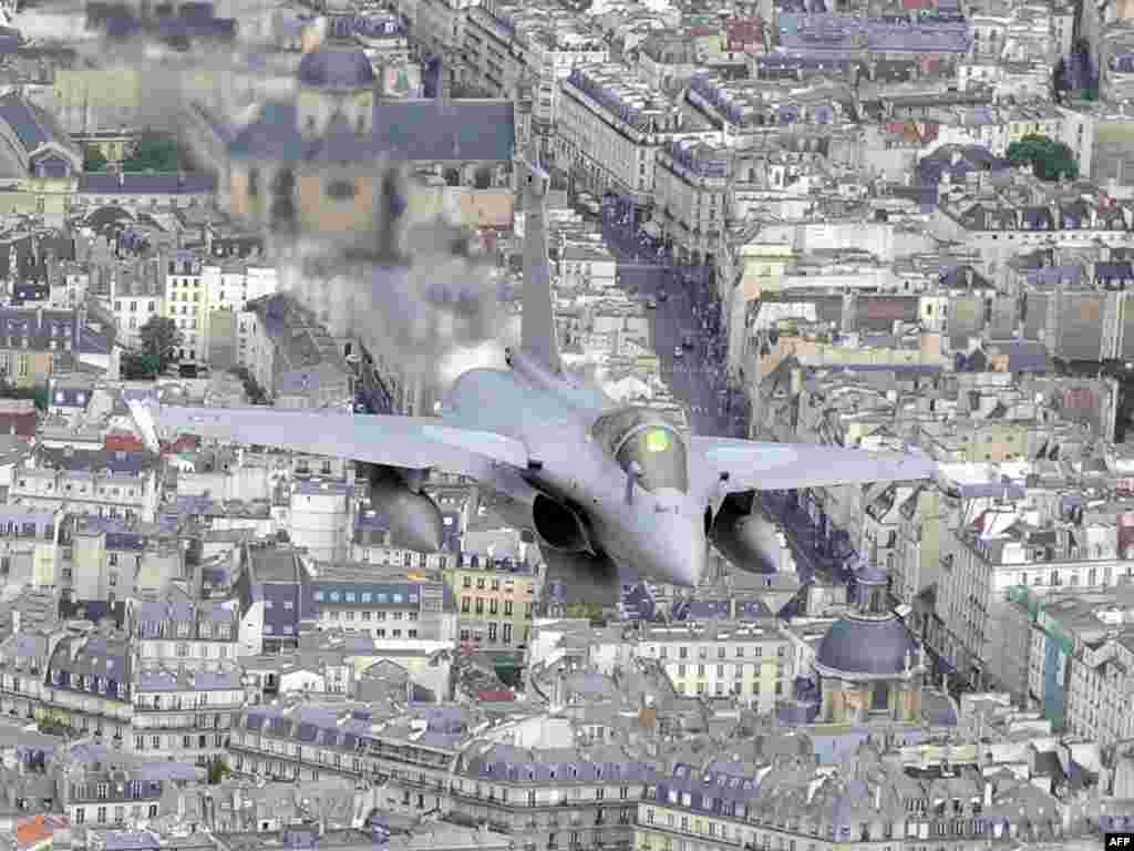 "French ""Rafale"" jets fly over Paris during the Bastille Day annual military parade on July 14. Photo by Boris Horvat for AFP"