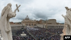 Vatican -- crowd gathered on St Peter's Square for dual canonization of Popes John XXIII and John Paul II on 27apr2014