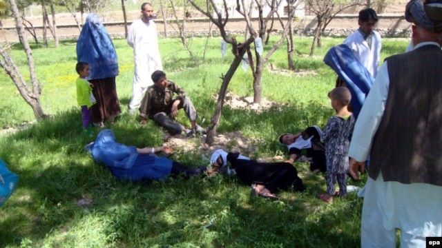 Schoolgirls in Takhar Province receive first aid after the suspected poisoning of their water supply.