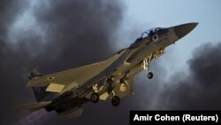 ISRAEL -- FILE PHOTO- An Israeli air force F-15 fighter jet flies during an exhibition as part of the graduation ceremony of air force pilots at Hatzerim air base in southern Israel June 25, 2015.