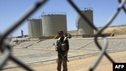 A security guard at the Tawke oil refinery near the village of Zacho, in Iraqi Kurdistan