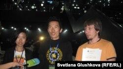Kazakhstan -- Tiantian Qiang (L), a Chinese cameraman; Vladimir Sim (C), a Kazakh producer; Roman Sukhosyr (R), a Kazakh film editor - the winners of the Best Video Award of the Art Fest. Astana, 03Jul2012