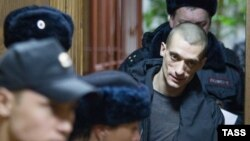 Russian artist Pyotr Pavlensky appears in Moscow's Tagansky district court in February charged with setting fire to the entrance door of the FSB building at Lubyanka Square in Moscow.