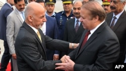 Pakistan Prime Minister Nawaz Sharif (R) greets Afghan President Ashraf Ghani upon his arrival at the military Nur Khan airbase in Rawalpindi on December 9, 2015.