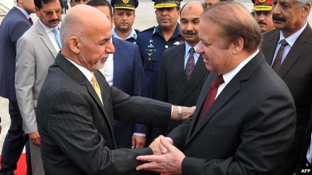 Pakistan Prime Minister Nawaz Sharif (right) greets Afghan President Ashraf Ghani upon his arrival in Rawalpindi on December 9.