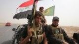 مقاتلون من قوات الحشد الشعبي في بيجي